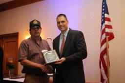 Owner Operator James Tim Cummings accepts plaque for IMTA Driver of the Month for October 2014.